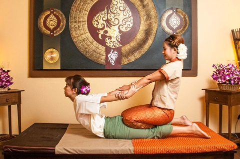 A woman receiving a Thai Massage