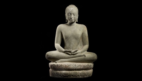 An old stone statue of the Buddha practicing Vipassana meditation